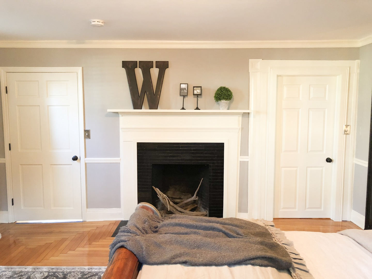 A person sitting in a living room at The Watson Boutique Bed & Breakfast.