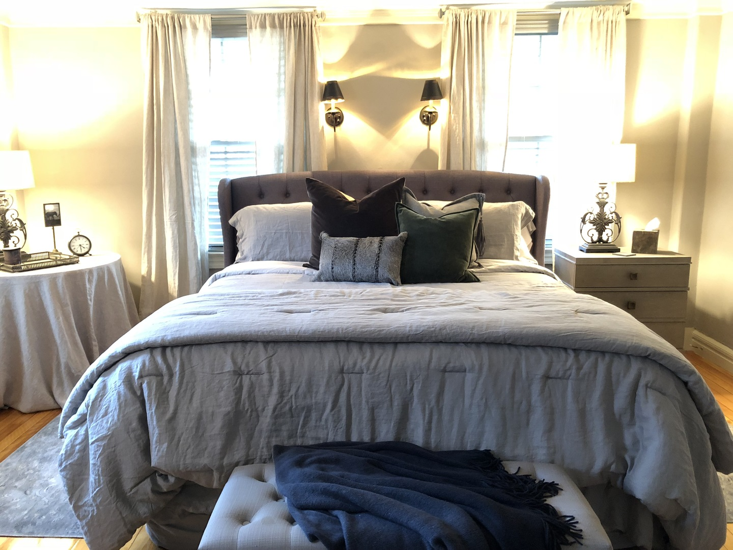 A bedroom with a large bed sitting in a room at The Watson Boutique Bed & Breakfast.