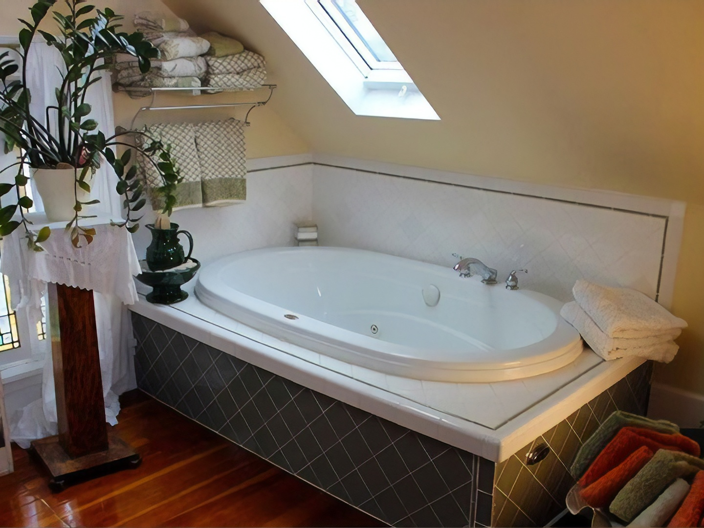 A white tub sitting next to a sink at Como Lake Bed and Breakfast.
