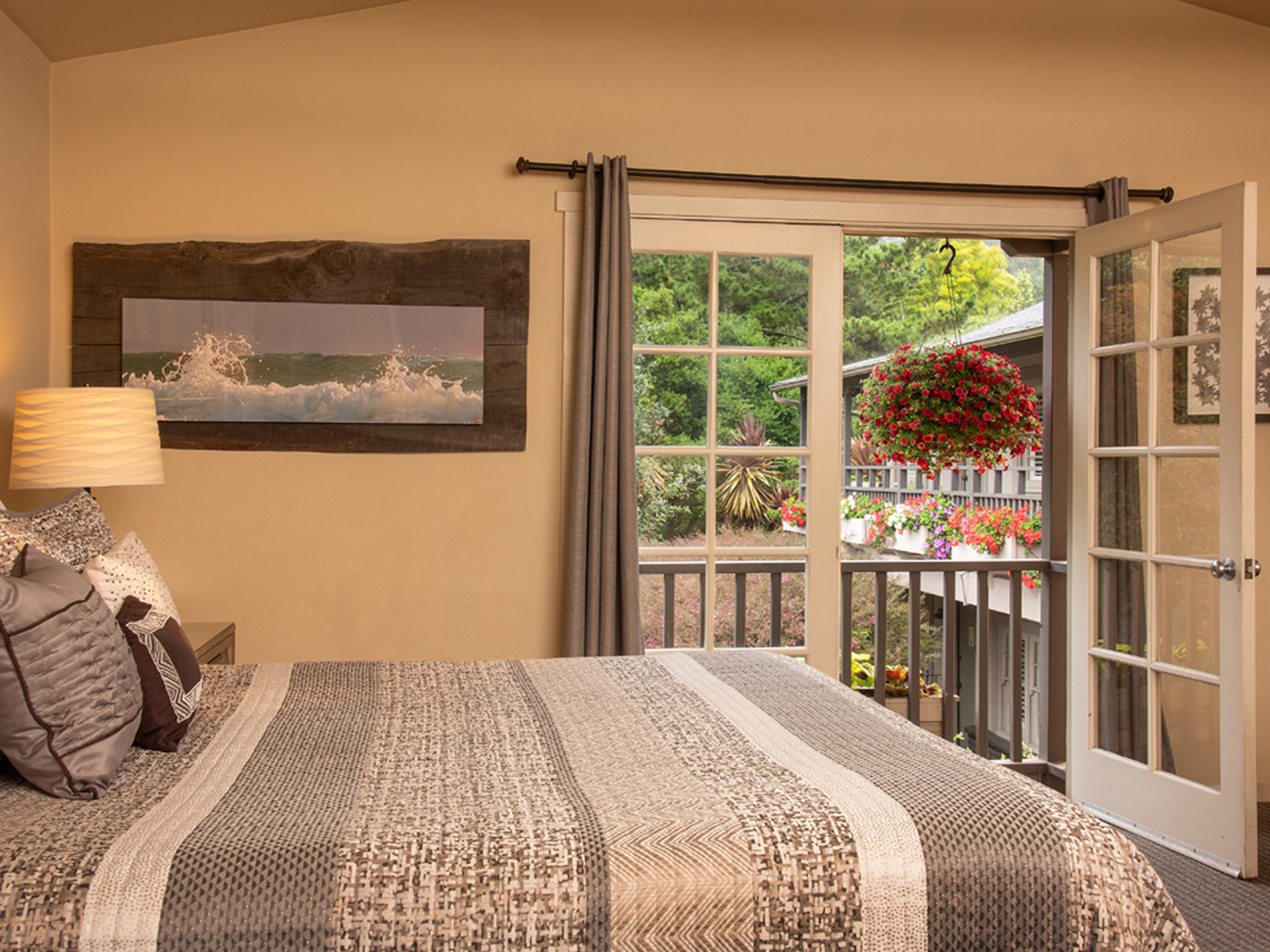 A bedroom with a large bed in a room at Carmel Country Inn.