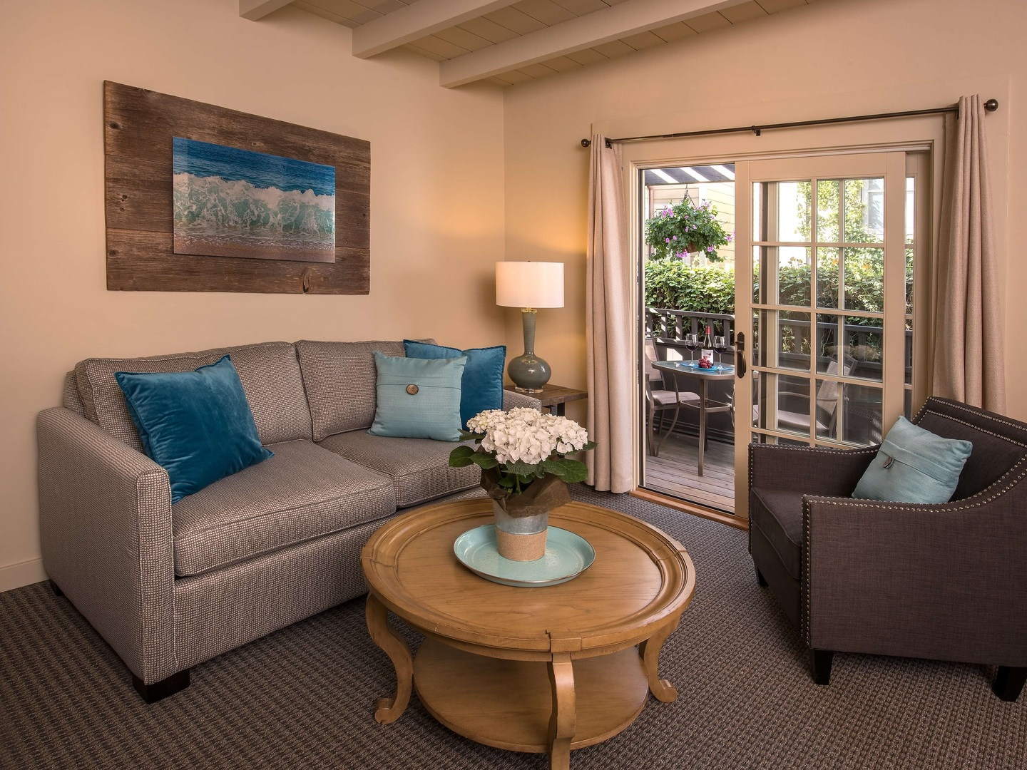 A living room filled with furniture and a large window at Carmel Country Inn.