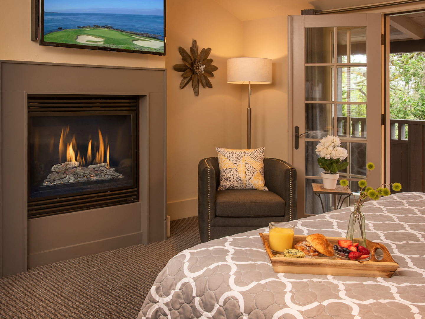 A fire place sitting in a living room at Carmel Country Inn.