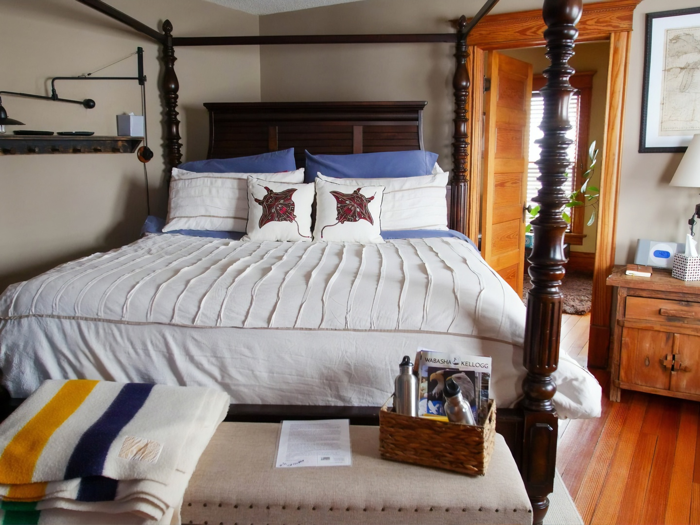 A bedroom with a bed and desk in a room at Turning Waters Bed, Breakfast & Adventure.