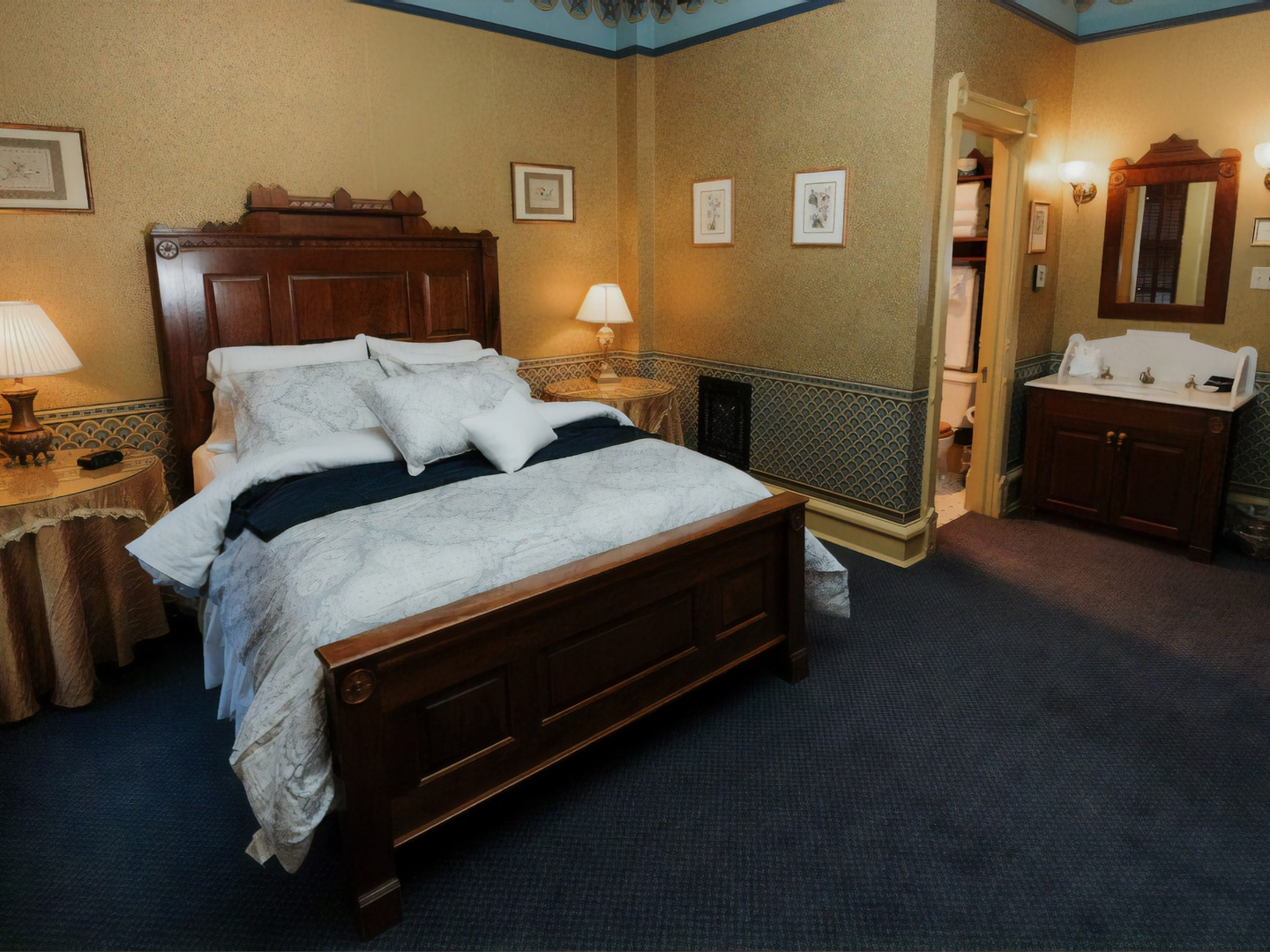 A bedroom with a bed and desk in a room at Inn at Pine Terrace.