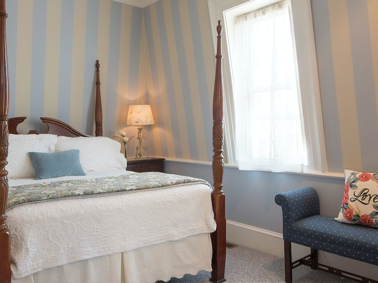 A bedroom with a bed and a chair in a room at Captain Farris House.