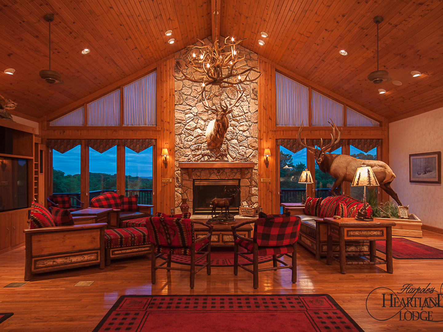 A room filled with furniture and a fire place at Harpole's Heartland Lodge.