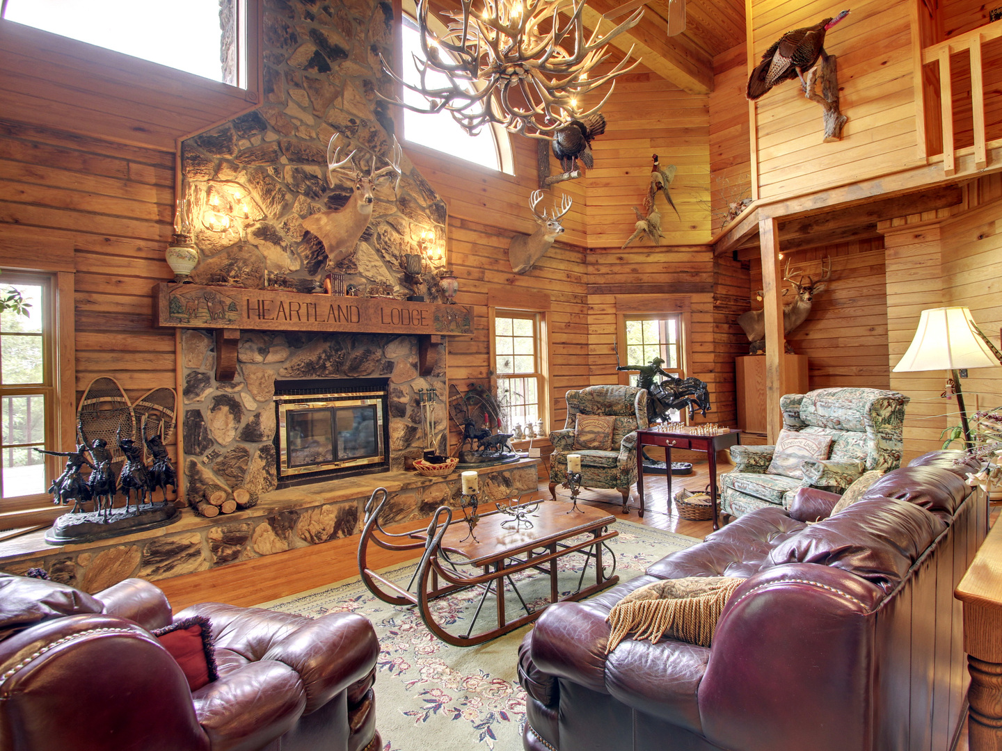 A living room filled with furniture and a fireplace at Harpole's Heartland Lodge.