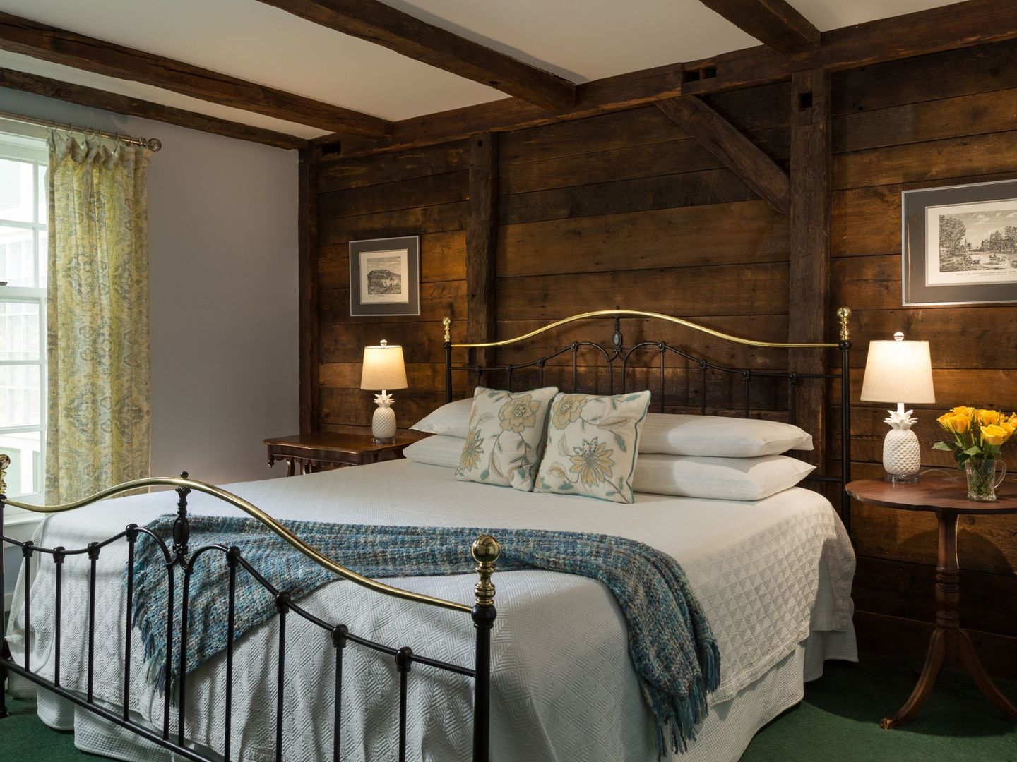 A bedroom with a large bed in a room at Chesterfield Inn.