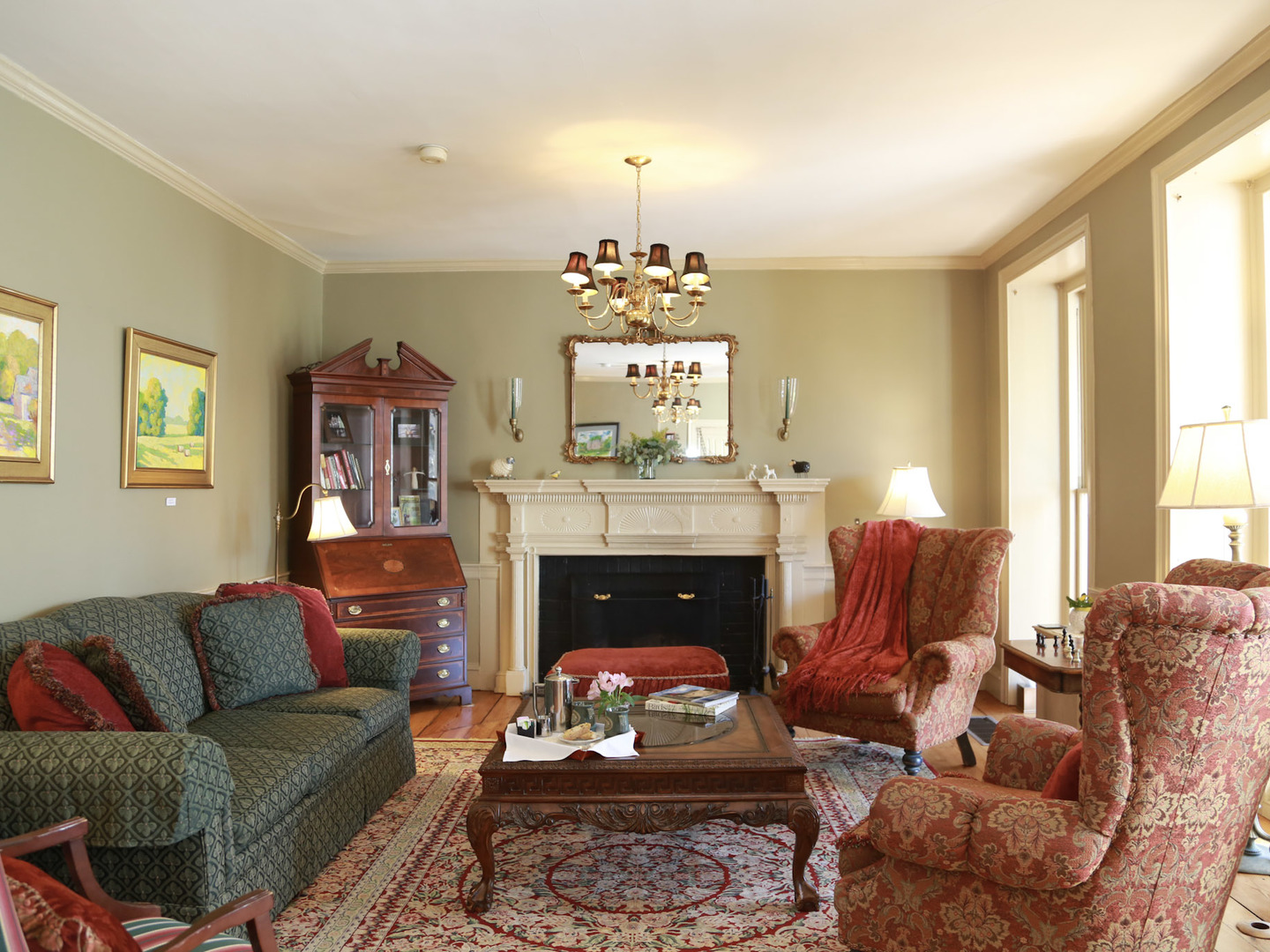 A living room filled with furniture and a fire place at Woolverton Inn.