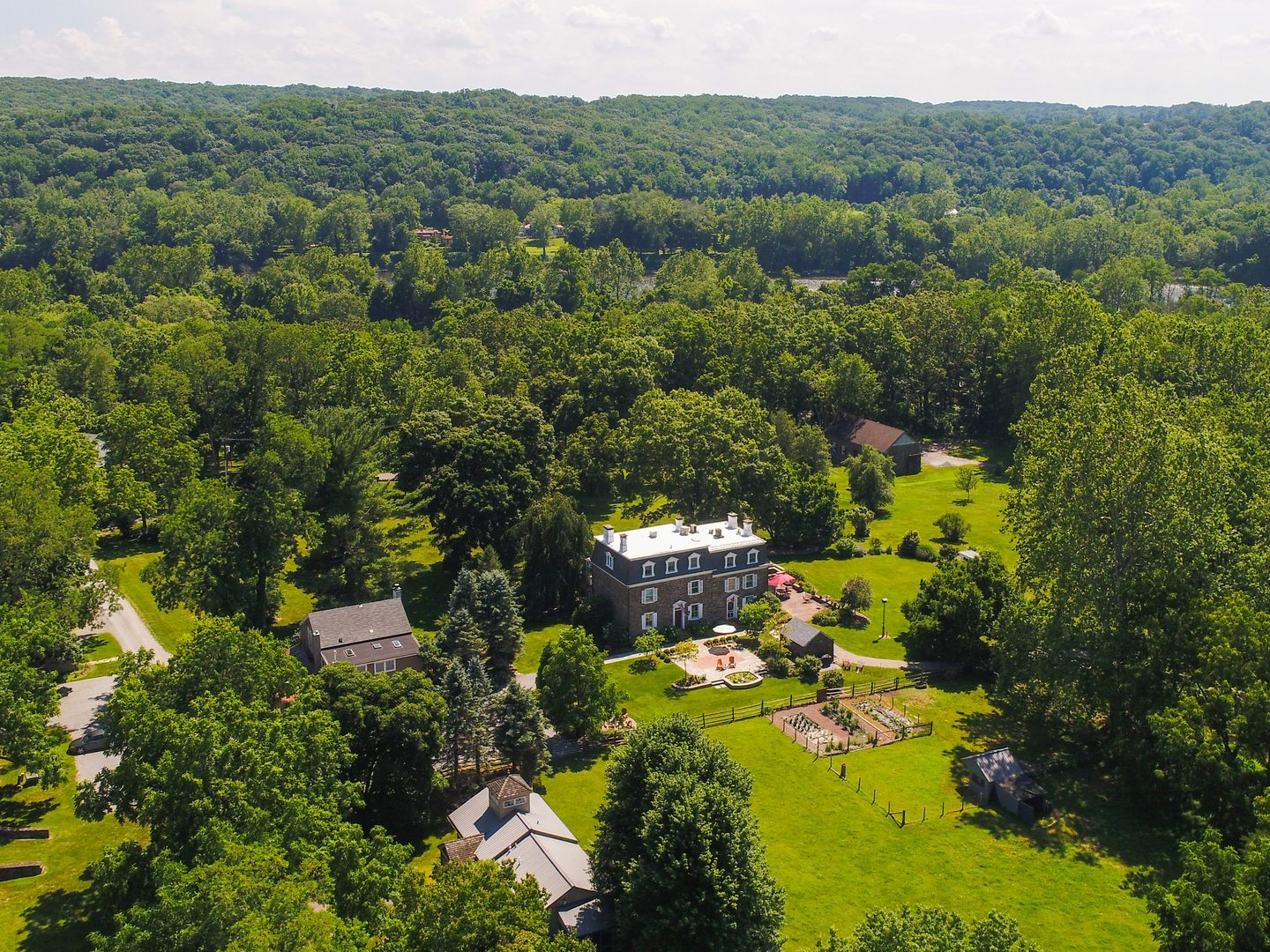 A large green field with trees in the background at Woolverton Inn.