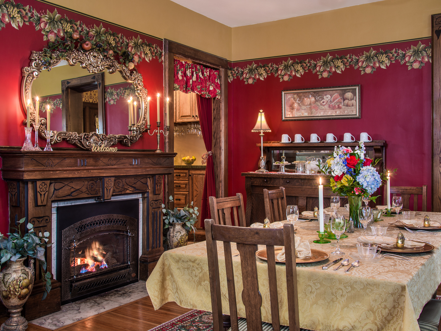 A fireplace in a living room filled with furniture and a fire place at 1840 Inn On the Main Bed and Breakfast.