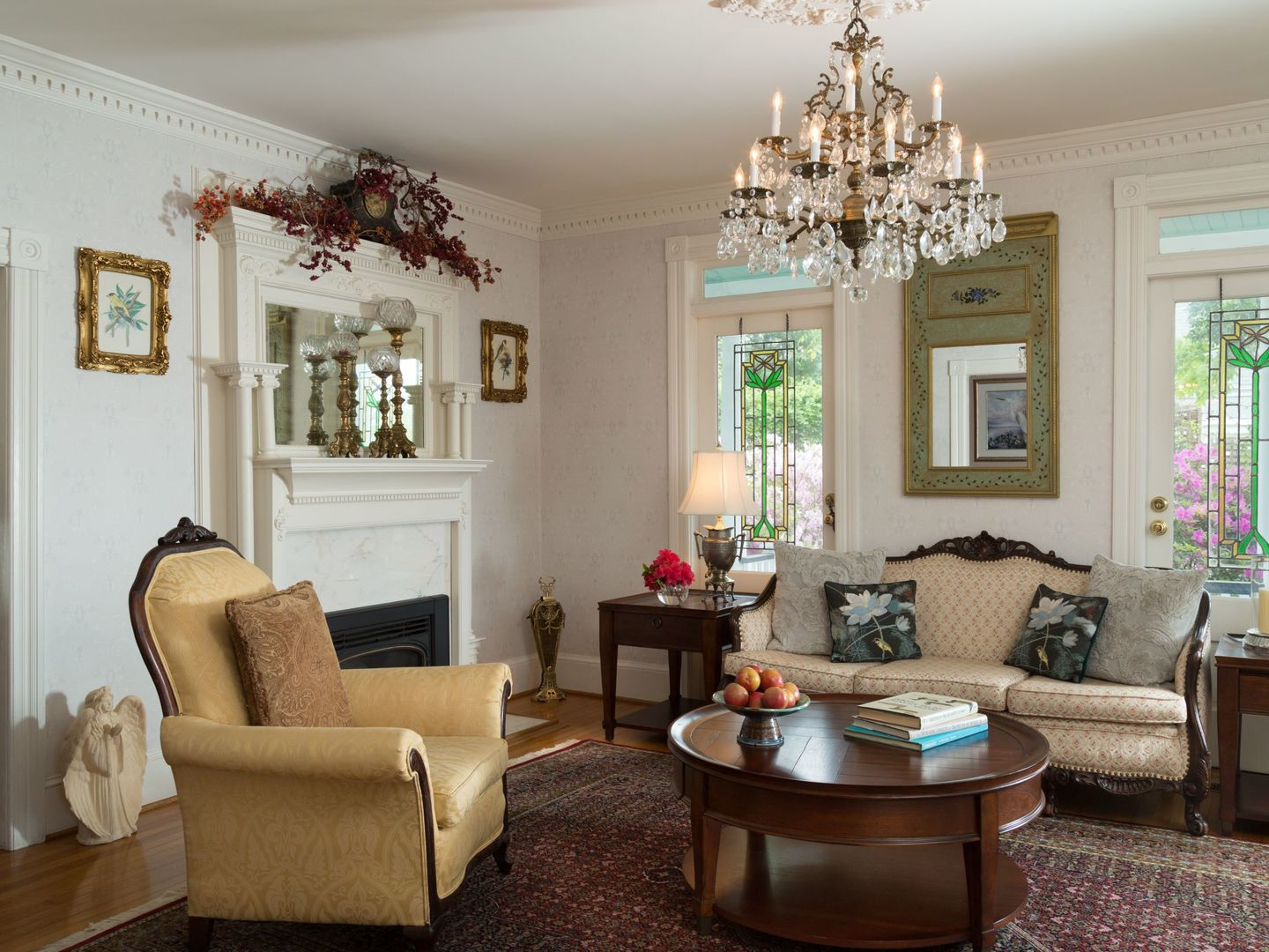 A living room filled with furniture and a fire place at White Doe Inn.