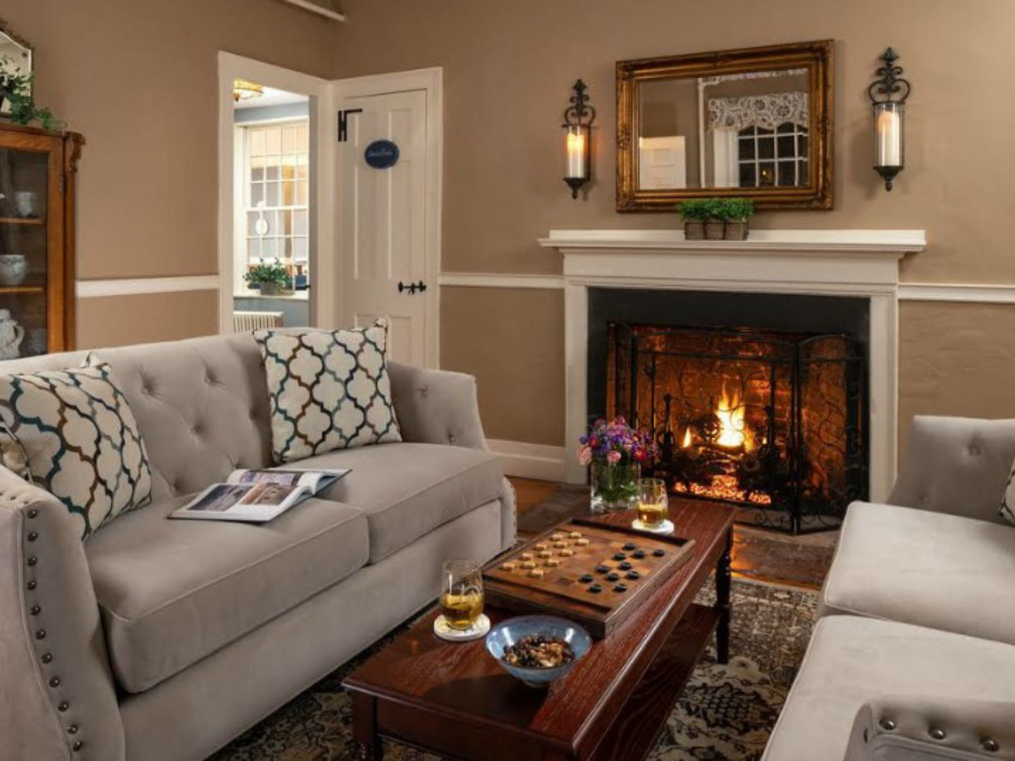 A living room filled with furniture and a fire place at The Captain Swift Inn.