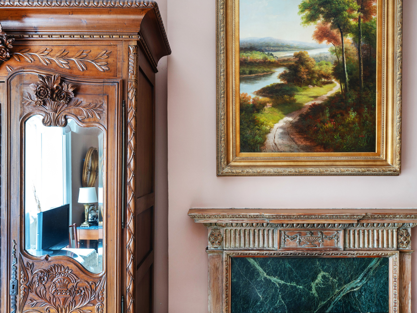 A painting in a frame hanging on a wall at 1871 House.