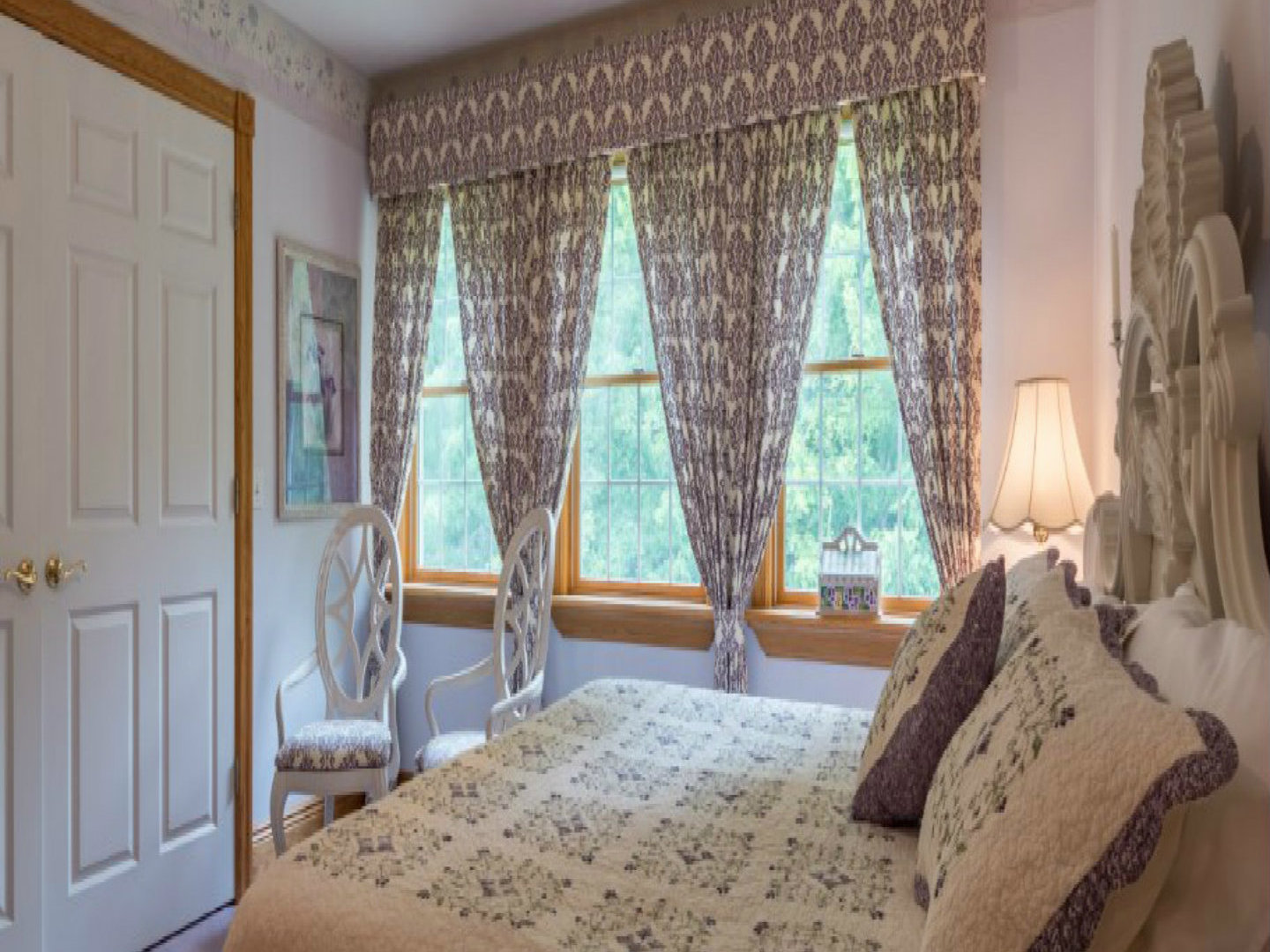 A bedroom with a bed and a window at Bear Creek Farm Bed and Breakfast .