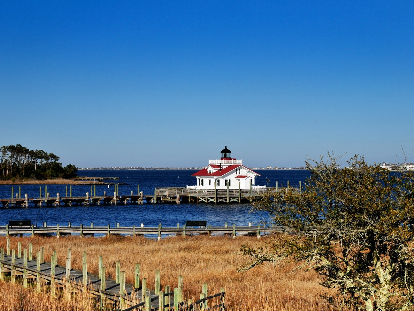 A bridge over a body of water at The Roanoke Island Inn.