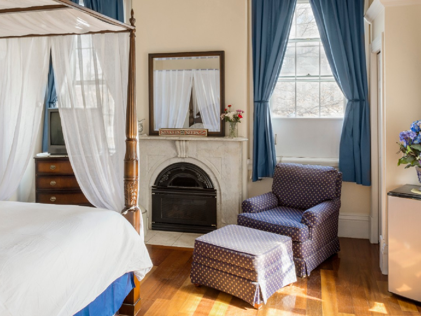 A bedroom with a bed and a chair in a room at Christopher Dodge House.