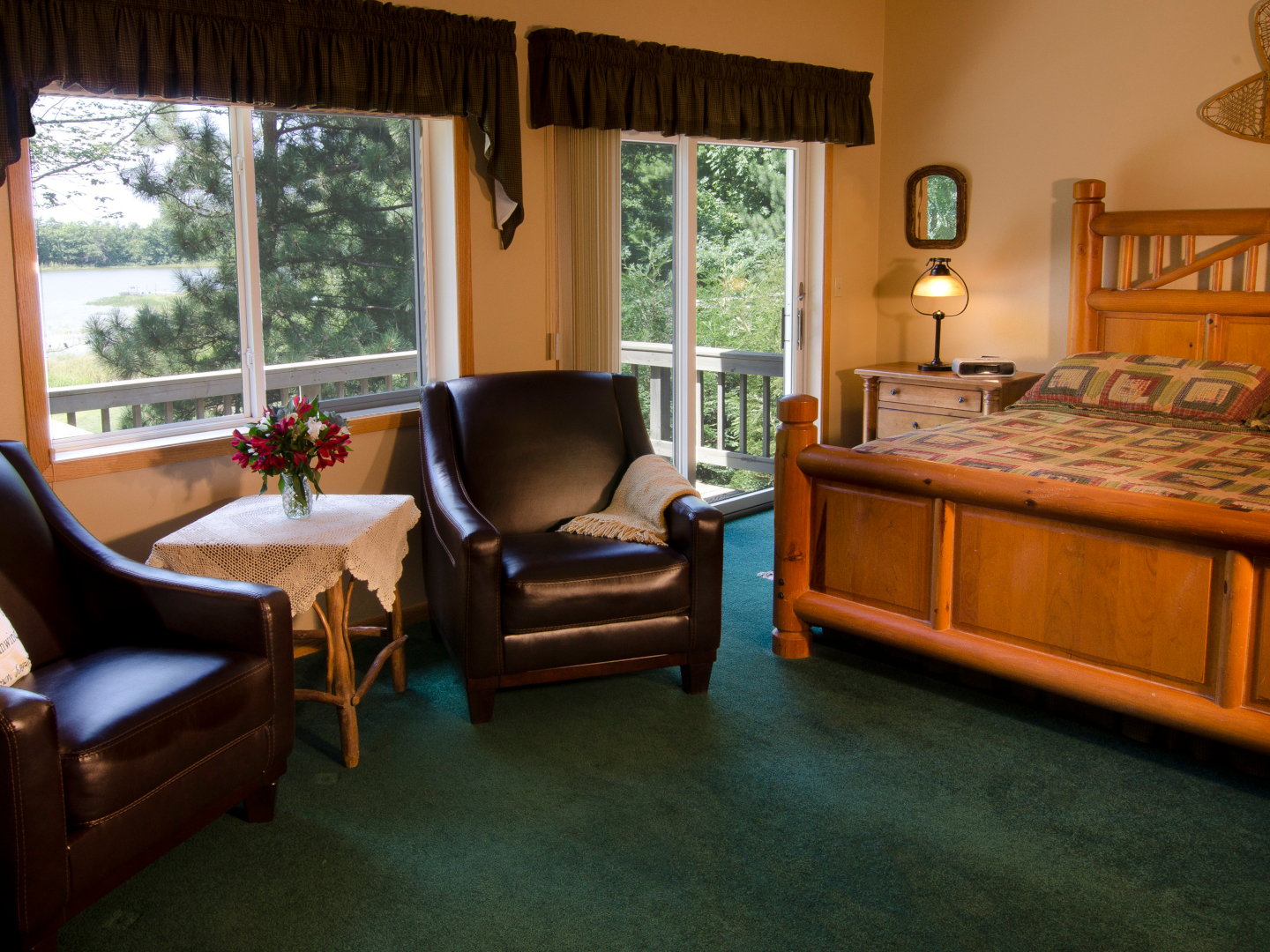 A living room filled with furniture and a large window at Canyon Road Inn.