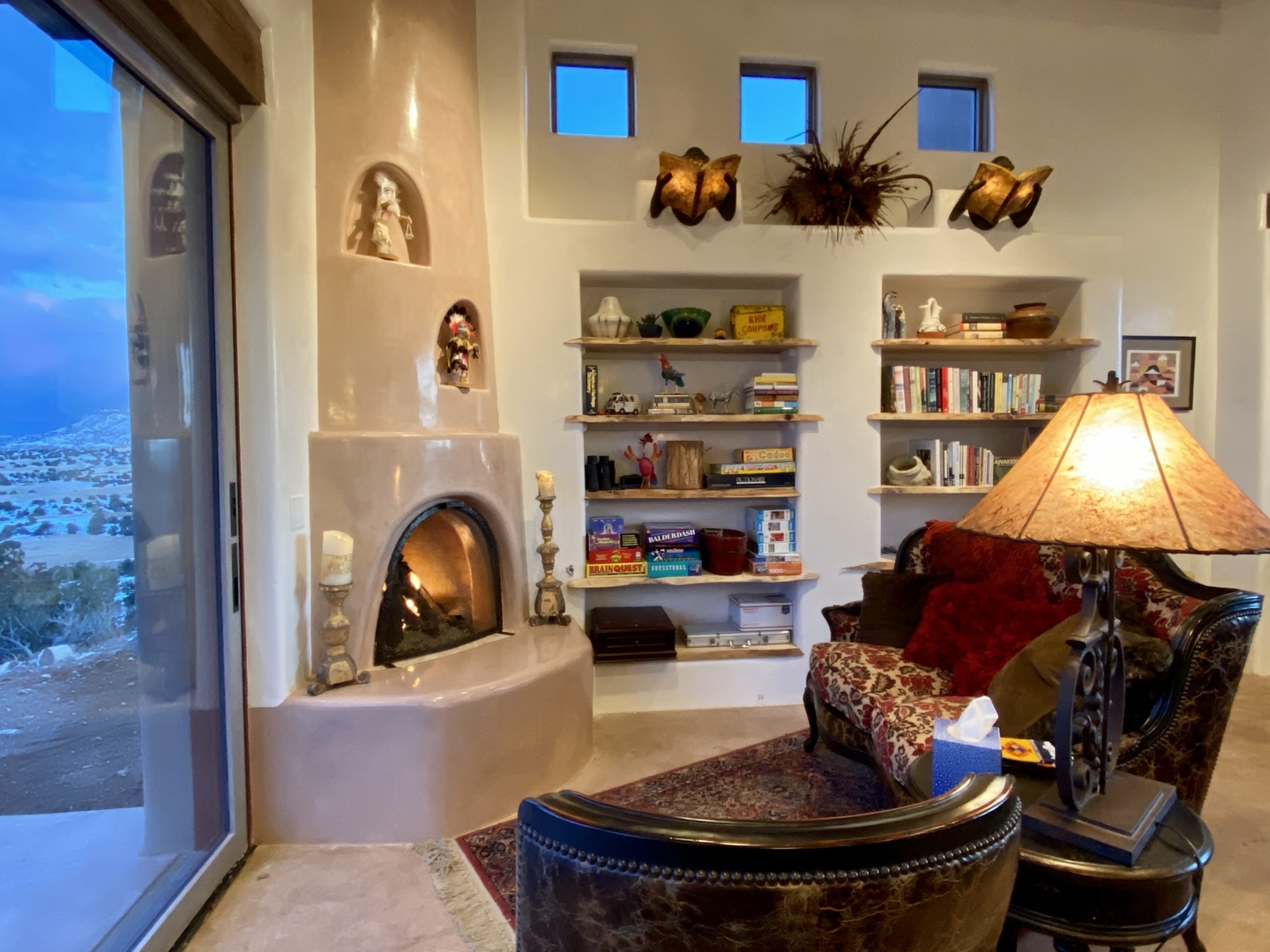 A room filled with furniture and a fireplace at Abiquiu Lake: The Grand Hacienda B&B.