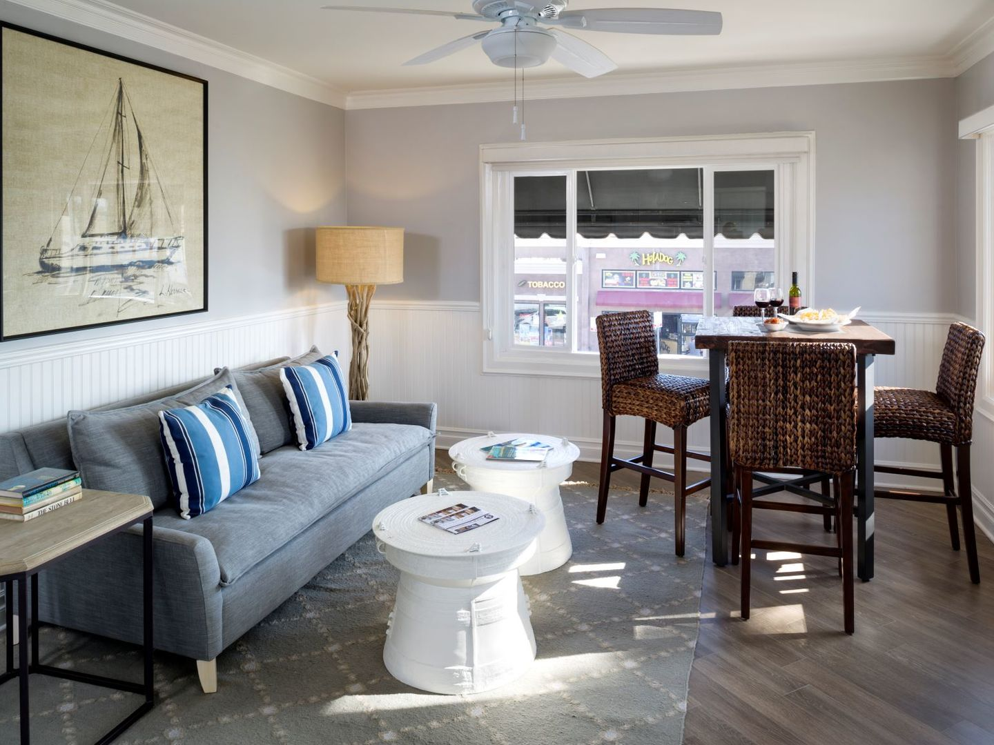 A living room filled with furniture and a large window at Newport Beach Hotel, A Four Sisters Inn.