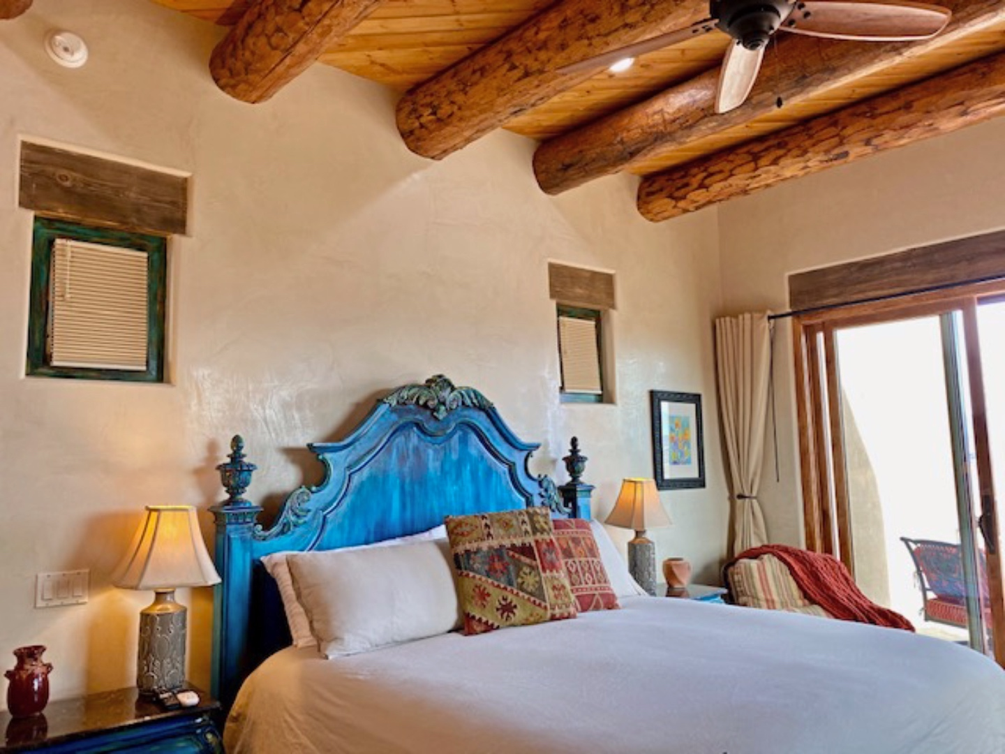 A bedroom with a bed and desk in a room at Abiquiu Lake: The Grand Hacienda B&B.