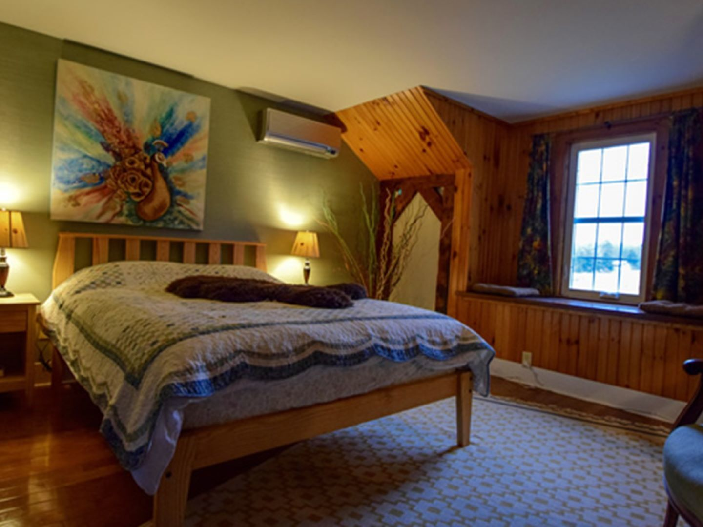 A bedroom with a bed and window in a room at Enfield Manor Bed and Breakfast and Vacation Rentals.