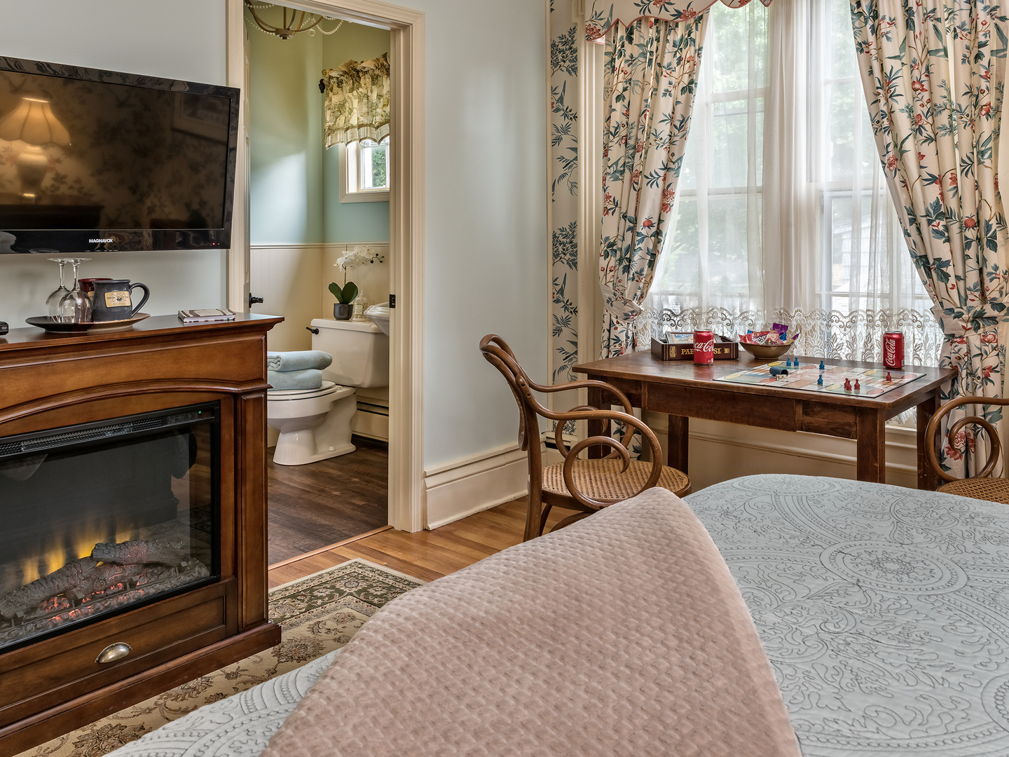 A living room filled with furniture and a fire place at Silver Heart Inn & Cottages.