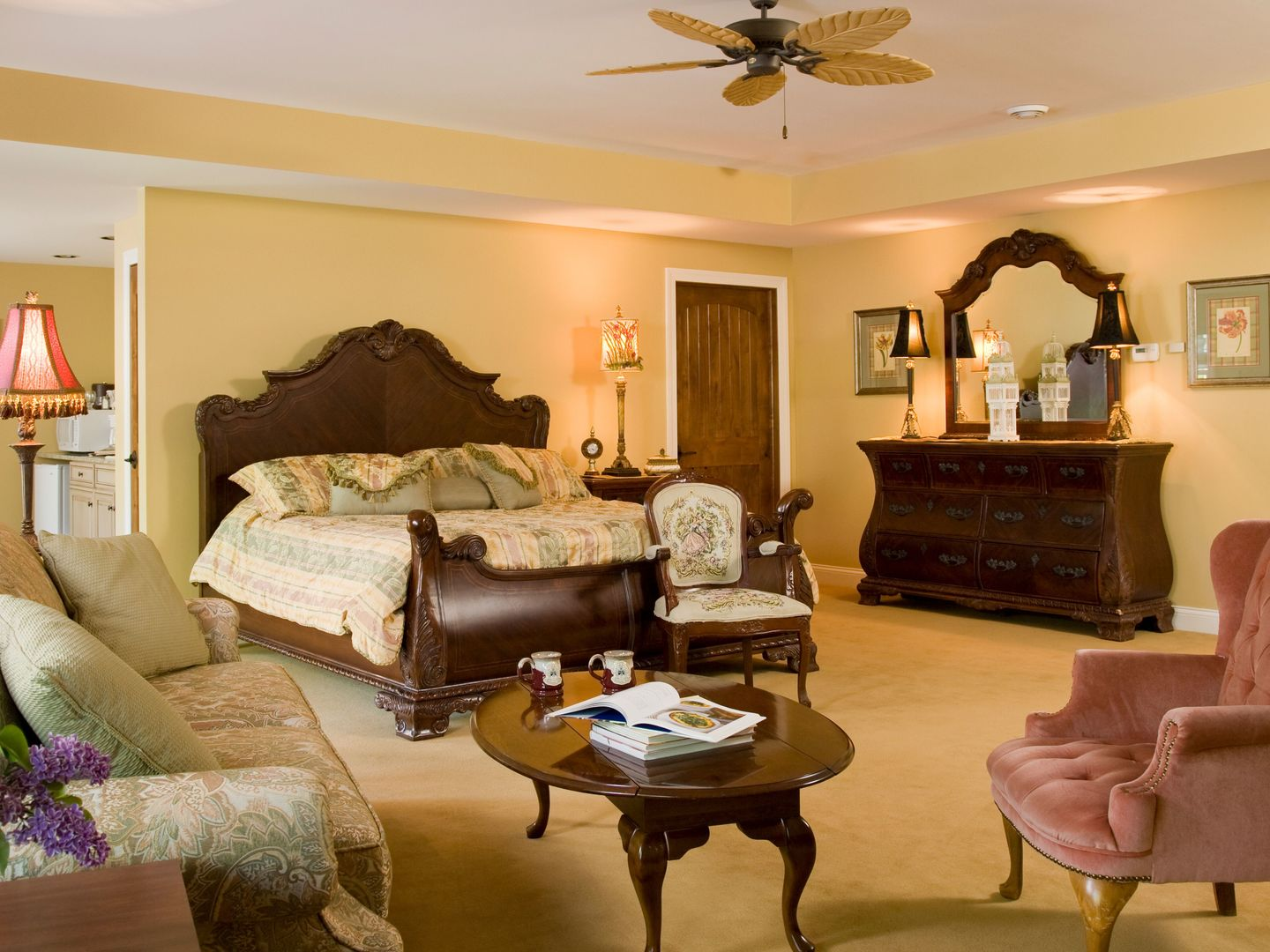 A living room filled with furniture and a fire place at Goldmoor Inn.