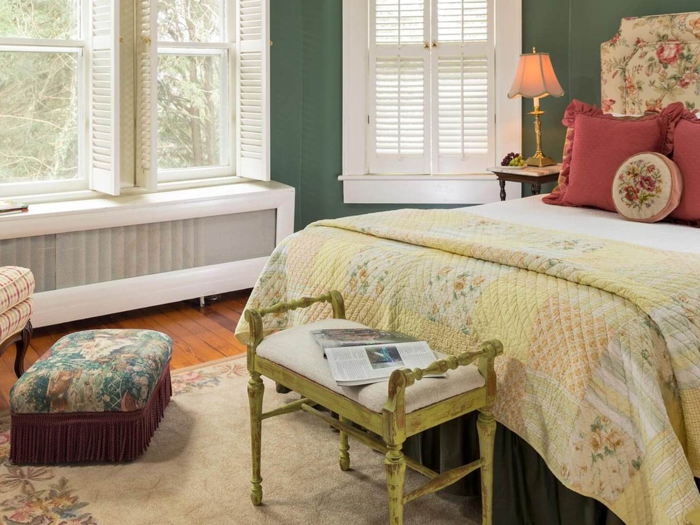 A living room with a bed and a window at The Yellow House Bed and Breakfast.