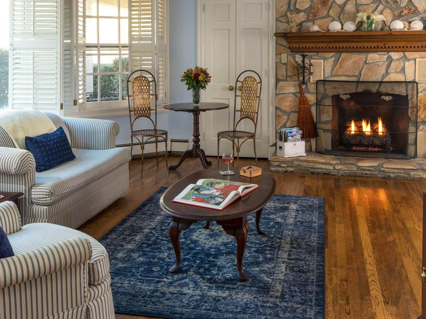 A living room filled with furniture and a fire place at The Yellow House Bed and Breakfast.