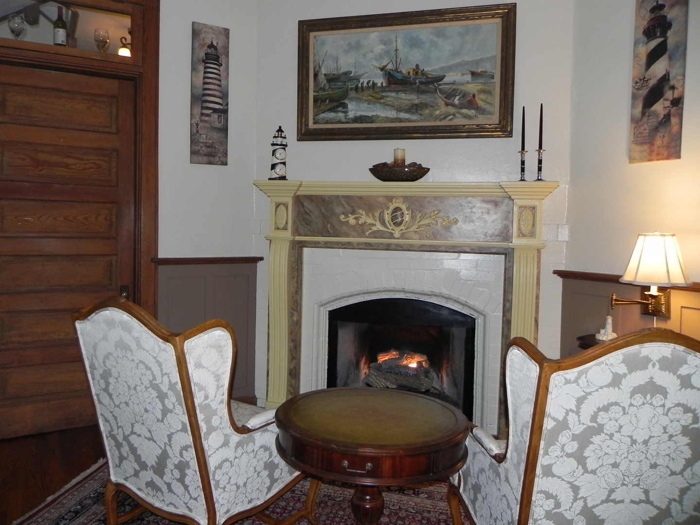 A fire place sitting in a living room filled with furniture and a fireplace at Vine Cottage Inn.