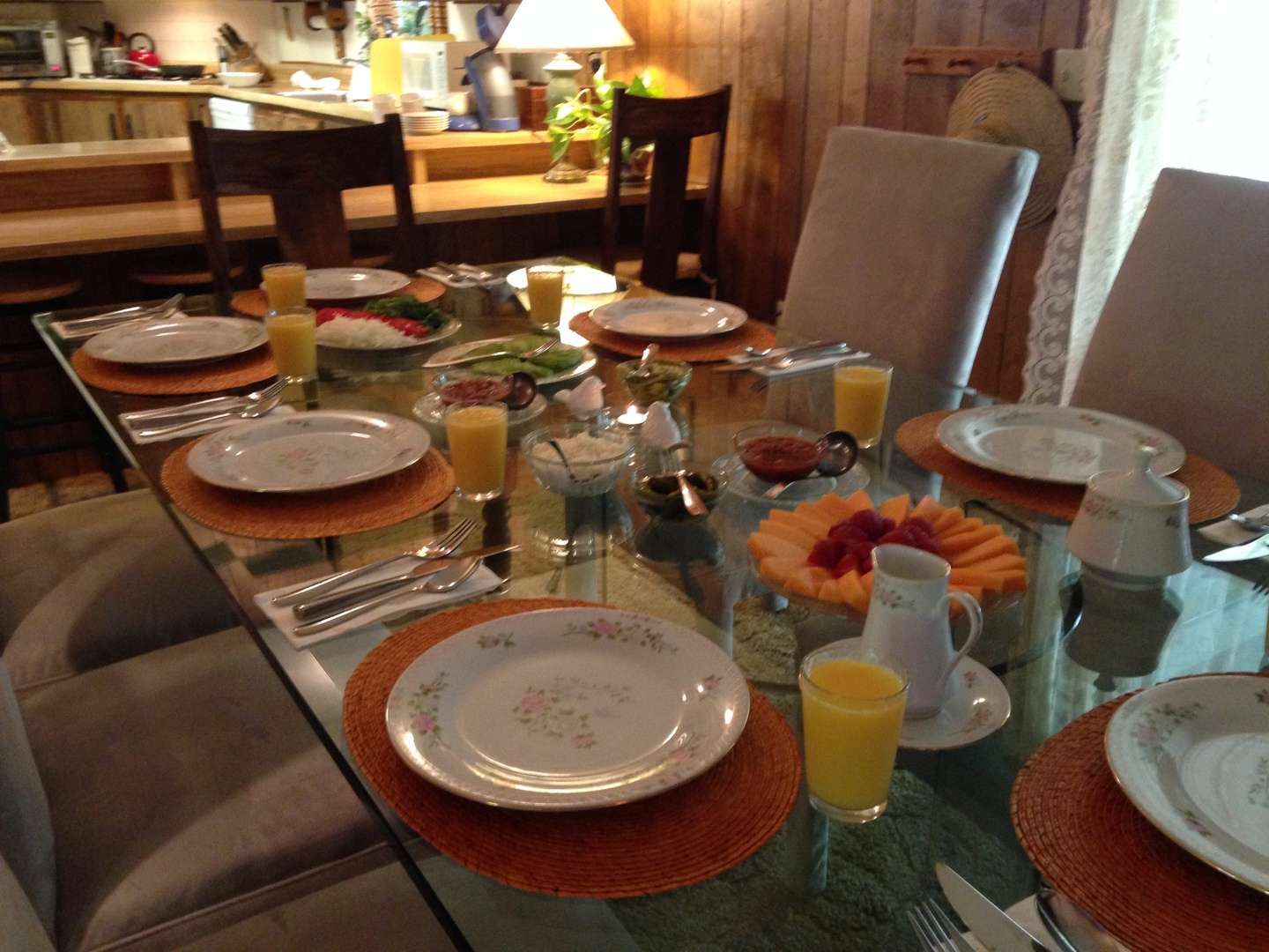 A dining table with a plate of food at Backyard Garden Oasis B&B.