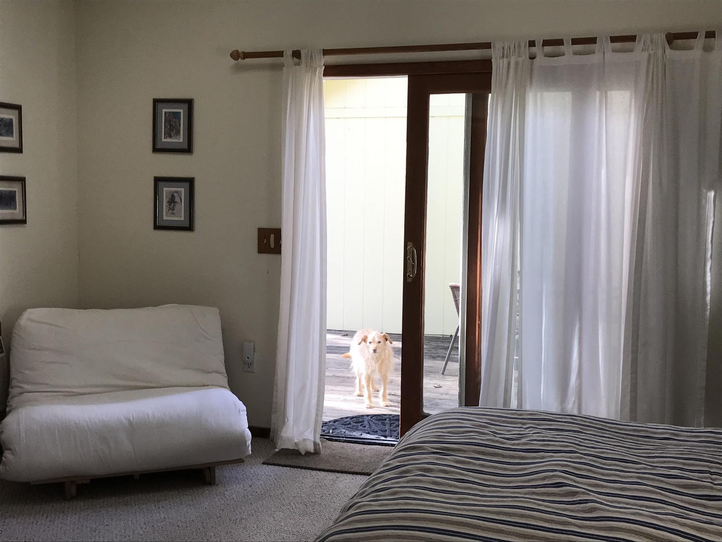 A bedroom with a large bed in a room at Backyard Garden Oasis B&B.