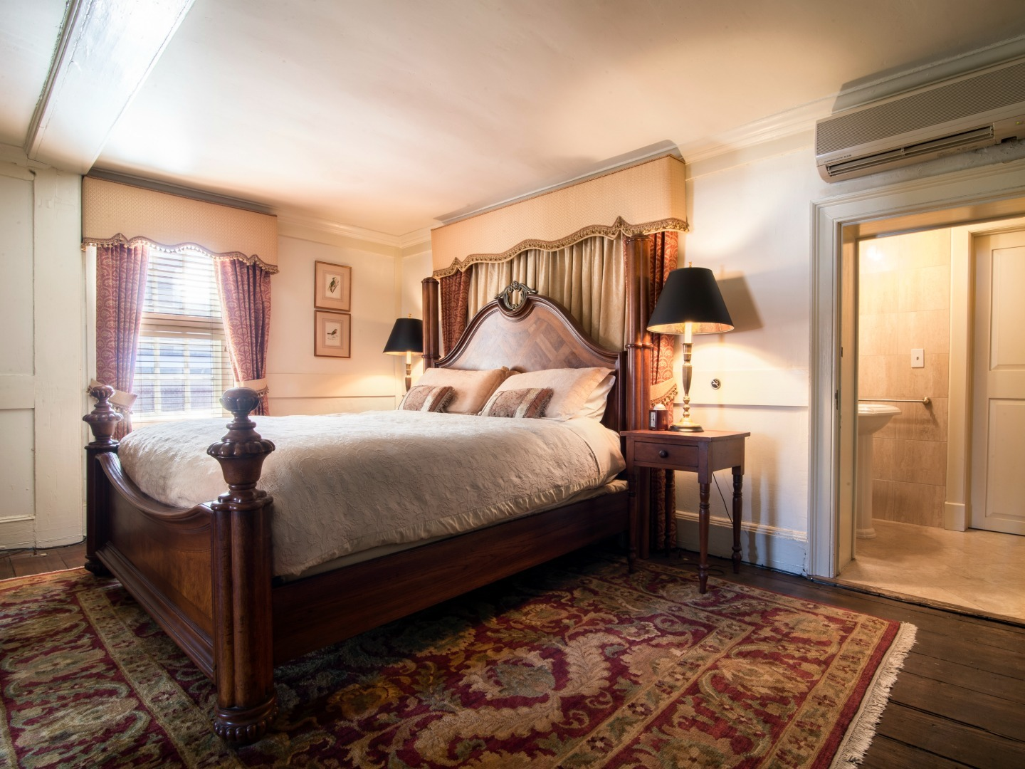 A bedroom with a large bed in a room at Reynolds Tavern.