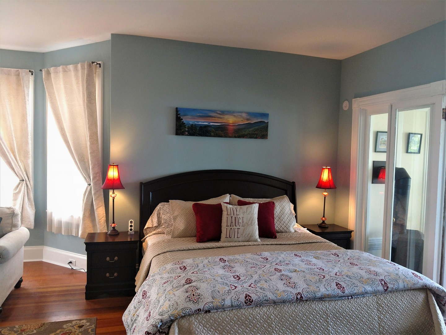 A bedroom with a large bed sitting in a room at The Saltair Inn Waterfront B&B.