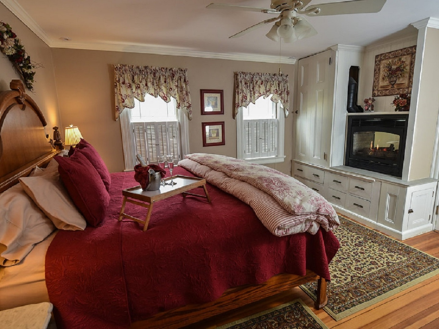 A living room filled with furniture and a fire place at The Saltair Inn Waterfront B&B.