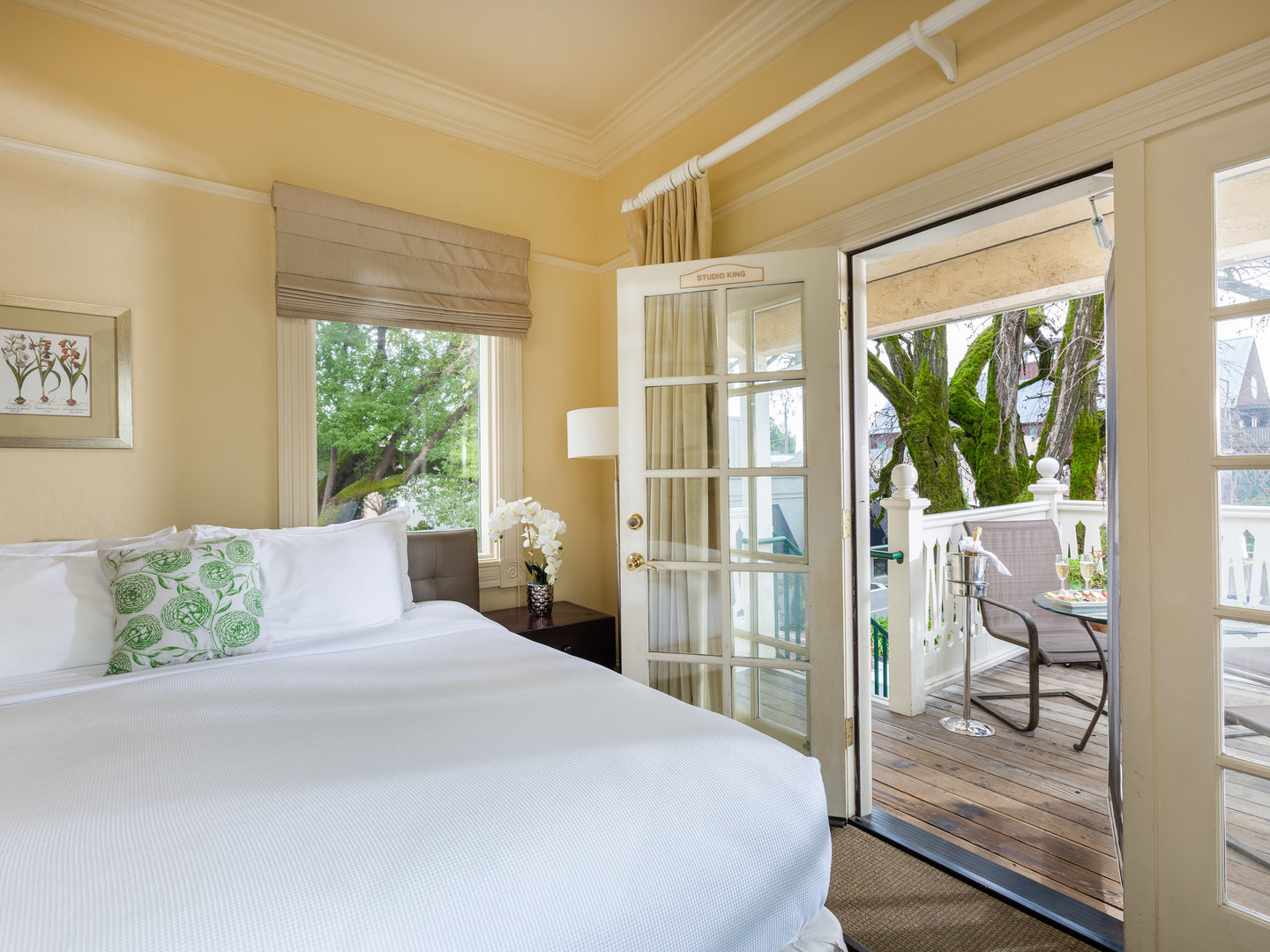 A large white bed in a bedroom next to a window at Healdsburg Inn, A Four Sisters Inn.