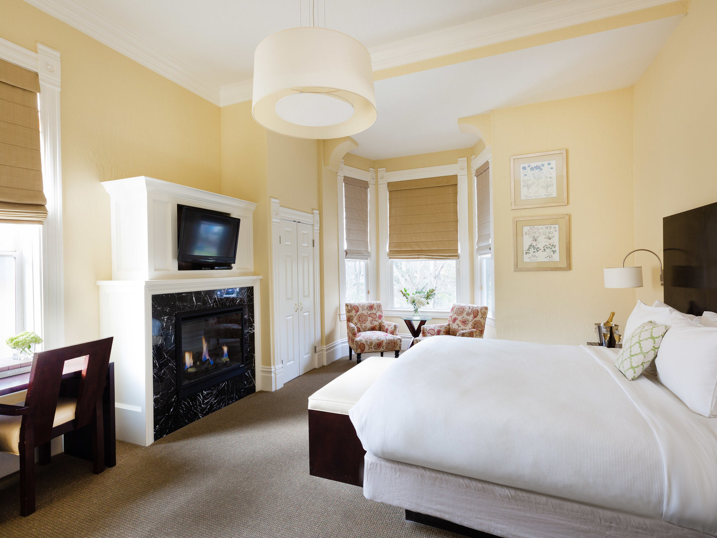 A bedroom with a large bed in a hotel room at Healdsburg Inn, A Four Sisters Inn.
