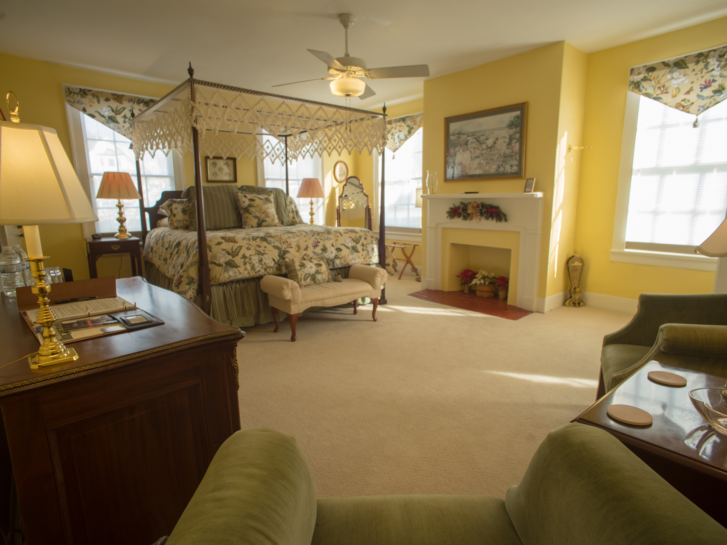 A living room filled with furniture and a large window at Benjamin Ellis House Bed & Breakfast.