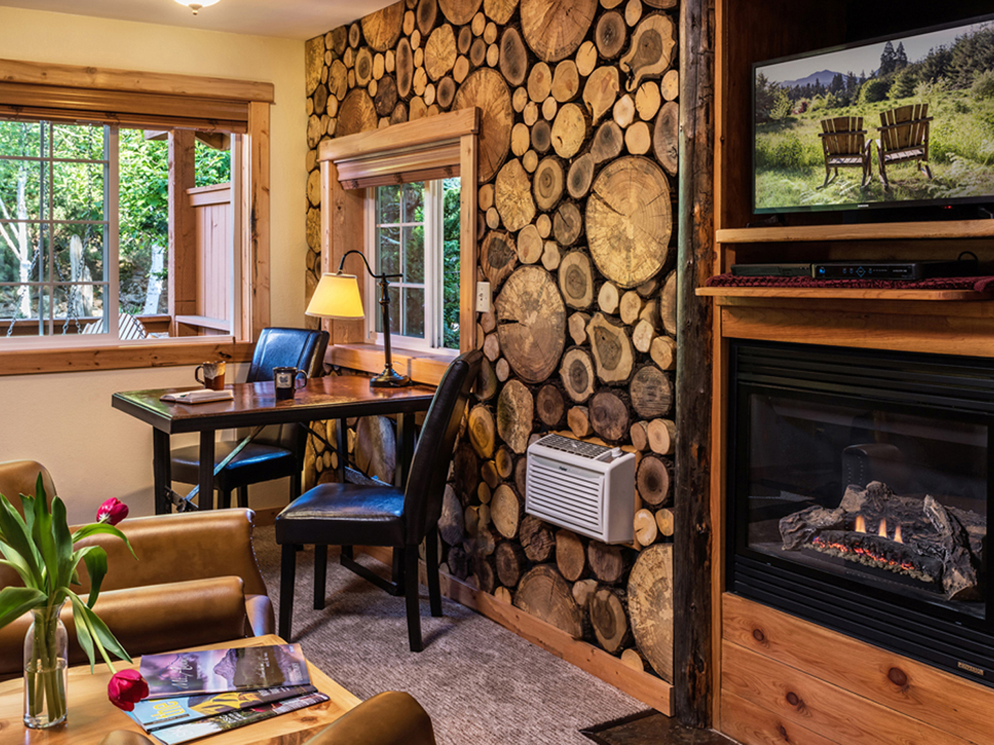 A living room filled with furniture and a fire place at Carson Ridge Luxury Cabins.