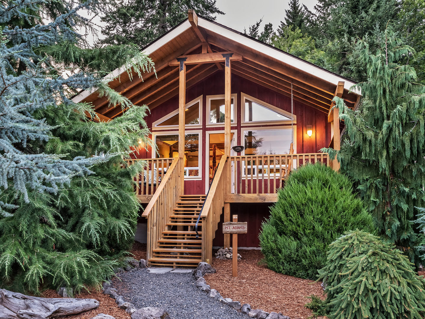 A tree in front of a house at Carson Ridge Luxury Cabins.