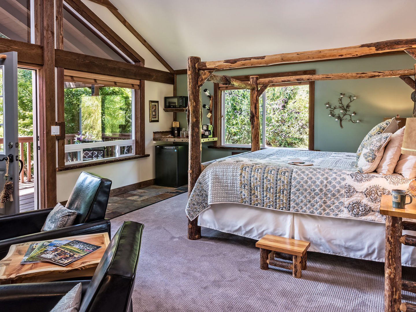 A bedroom with a bed and a chair in a room at Carson Ridge Luxury Cabins.