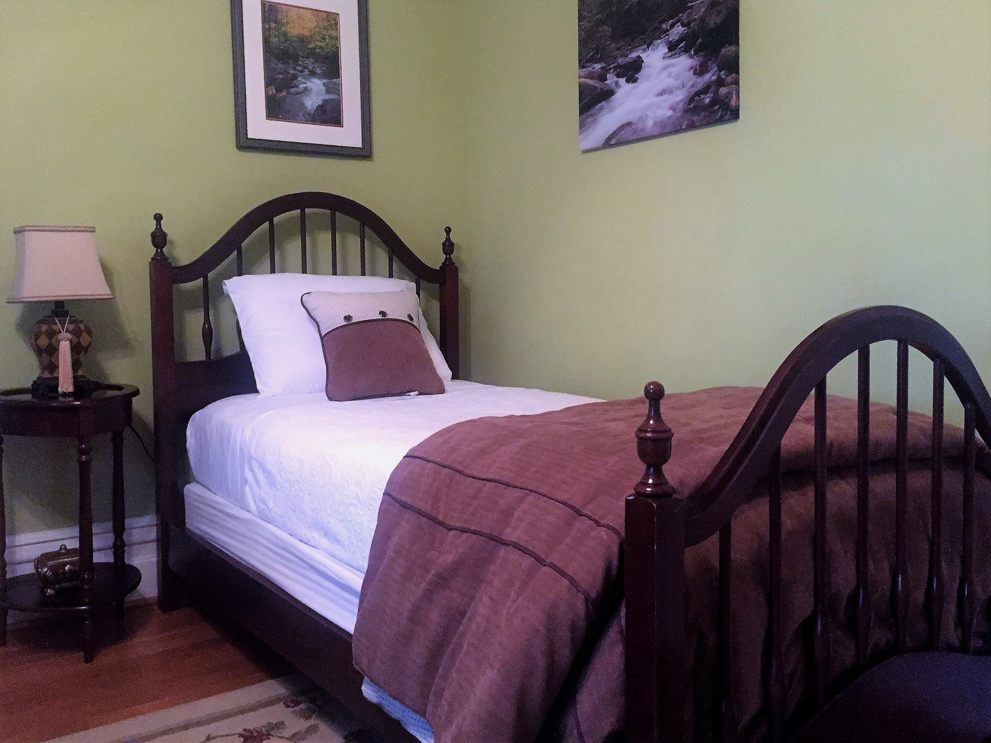 A bedroom with a large bed sitting in a room at Oak Hill on Love Lane Bed & Breakfast.