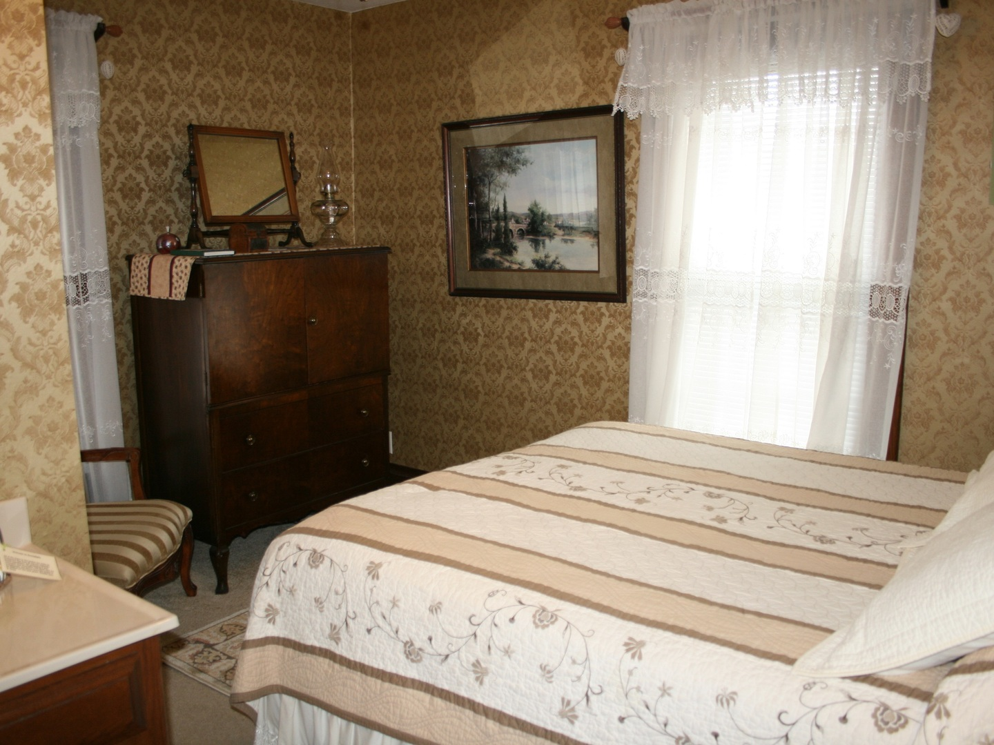 A bedroom with a bed and desk in a room at Serendipity Bed and Breakfast and Cottage.