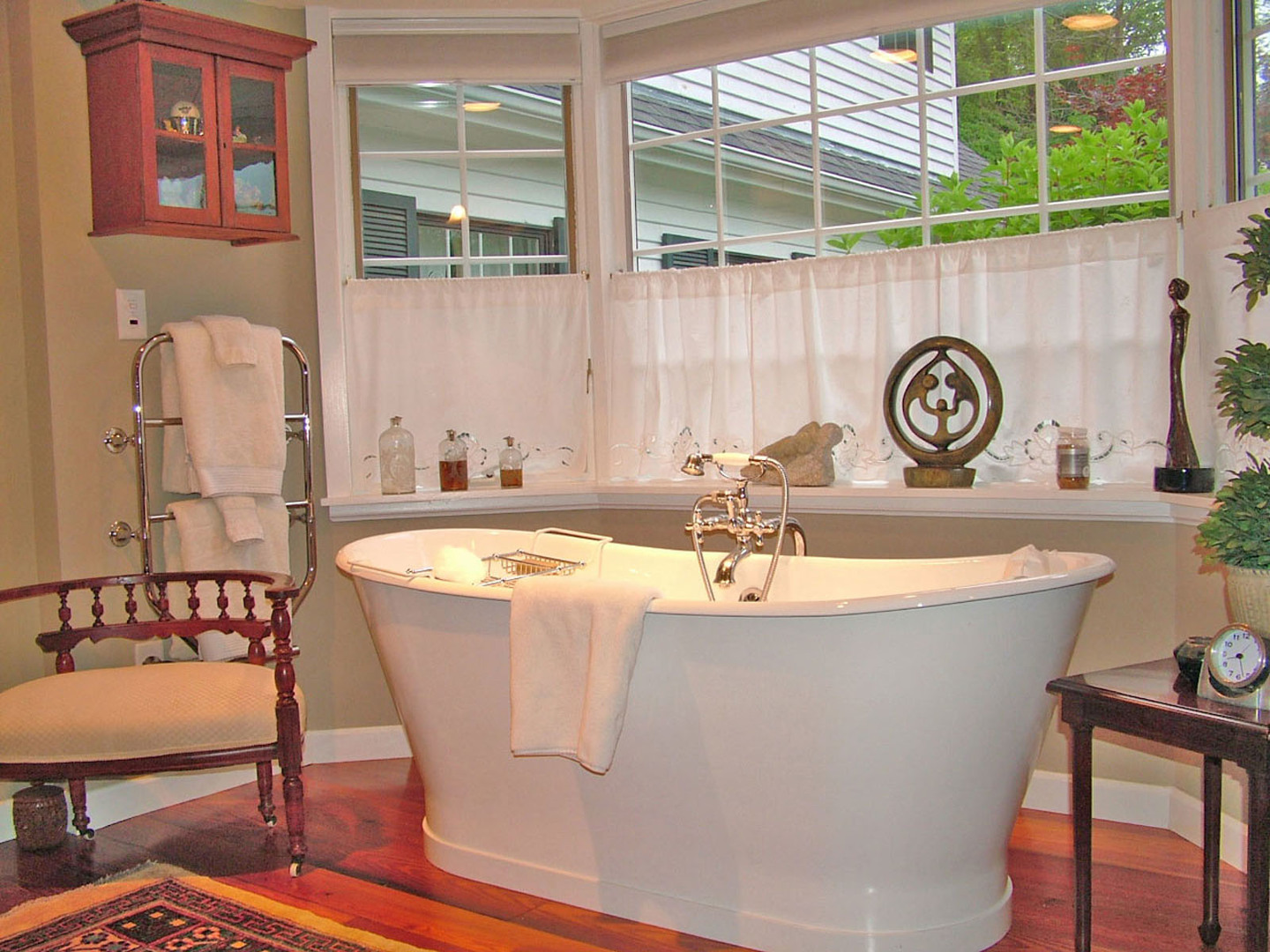 A large white tub sitting next to a window at The Welsh Hills Inn.