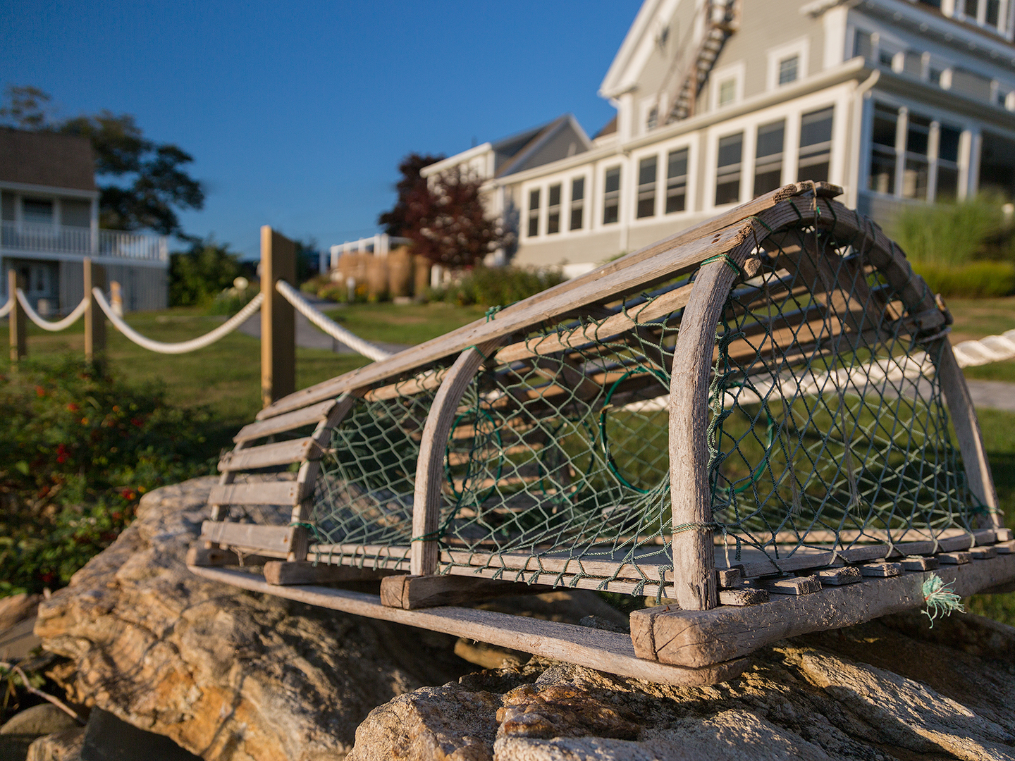 A bench in front of a building at Topside Inn.
