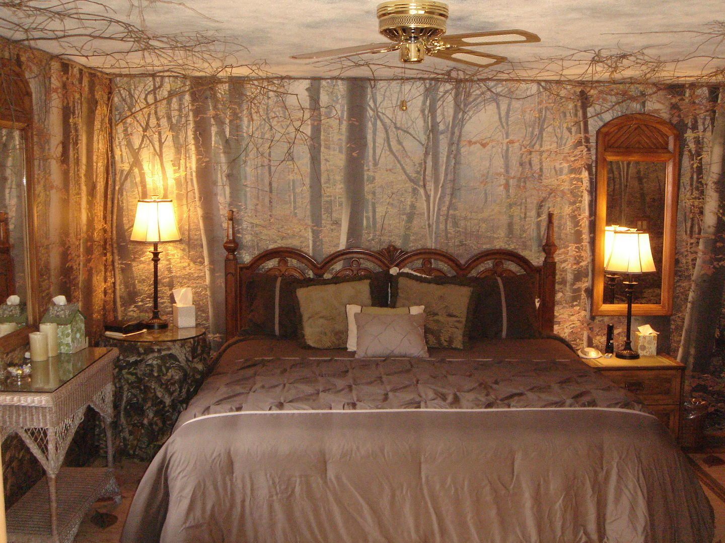 A bedroom with a large bed in a room at Inn by the Mill.