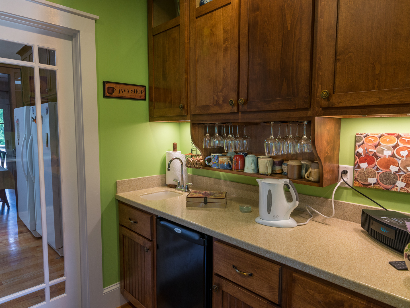 A kitchen with a sink and a microwave at Arbor House of Black Mountain Bed and Breakfast.