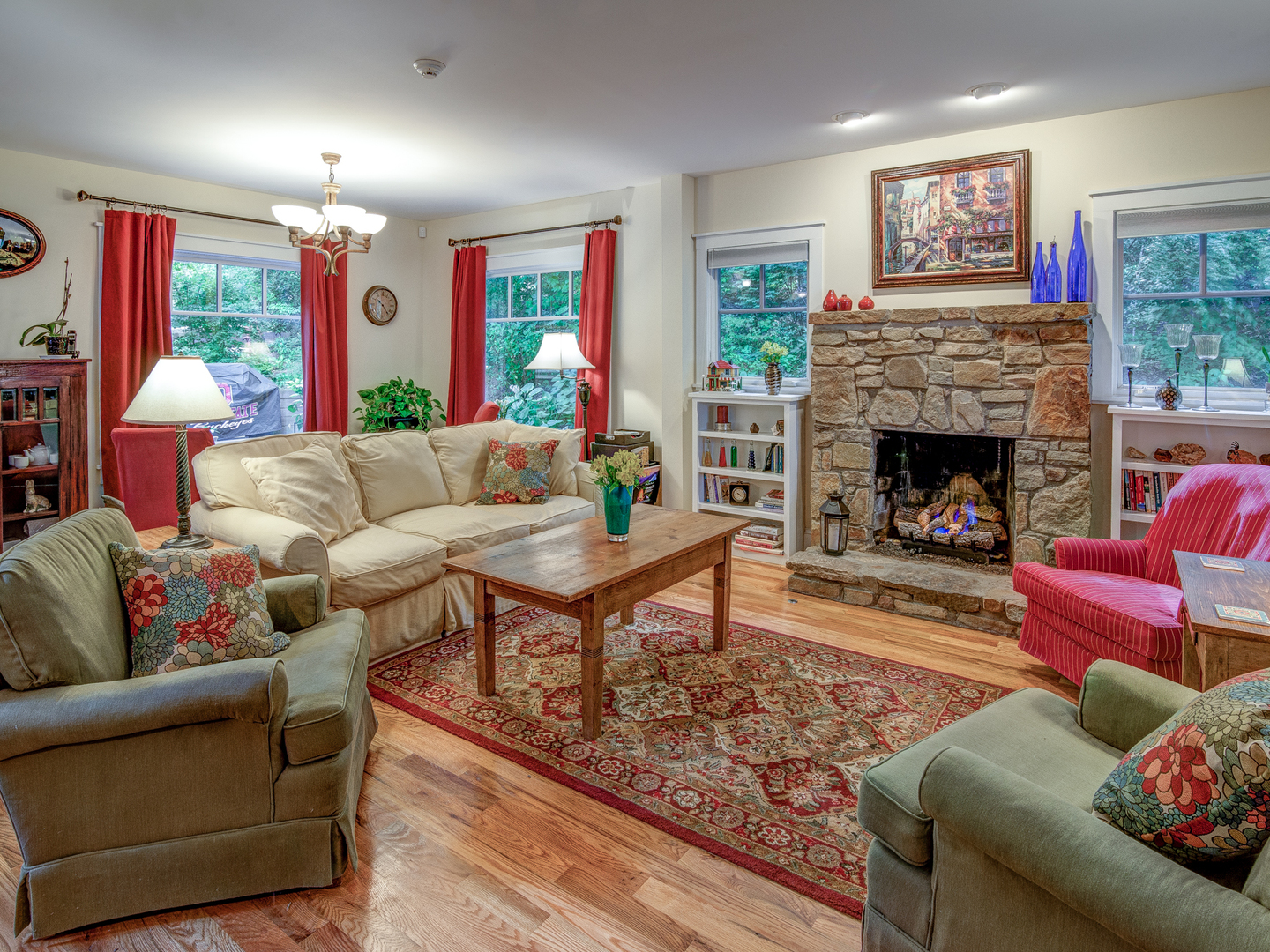 A living room filled with furniture and a fire place at Arbor House of Black Mountain Bed and Breakfast.