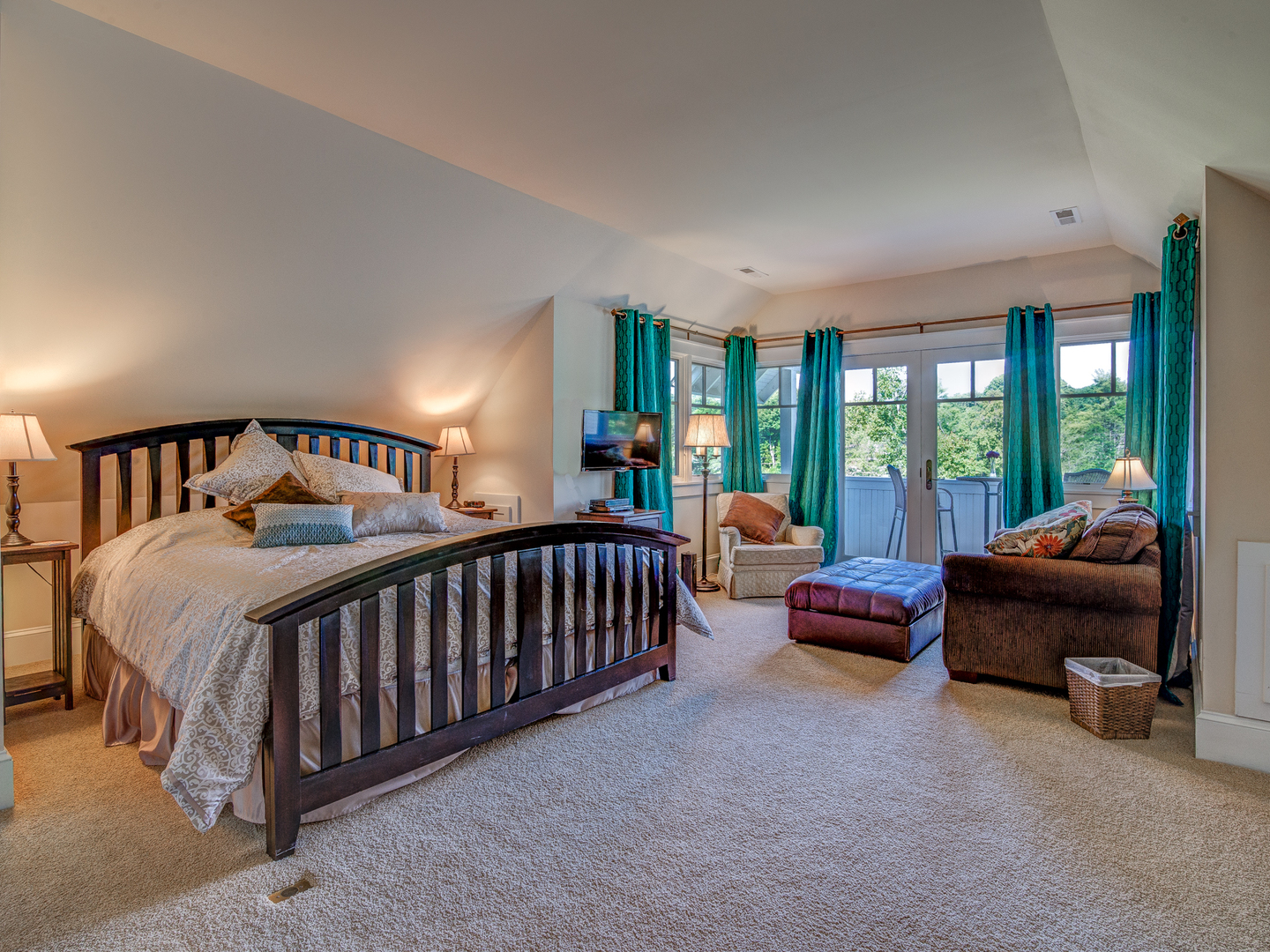 A living room filled with furniture and a bed in a bedroom at Arbor House of Black Mountain Bed and Breakfast.